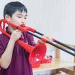 河内英国越南国际学校的学生练习吹号