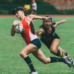新加坡美国学校的学生打橄榄球